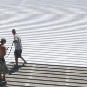 roofing contractors applying roof coating Singapore
