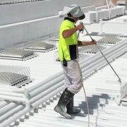 thermal insulation coating being applied onto a roof in Singapore