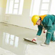 applying anti skid floor treatment as anti slip bathroom flooring Singapore