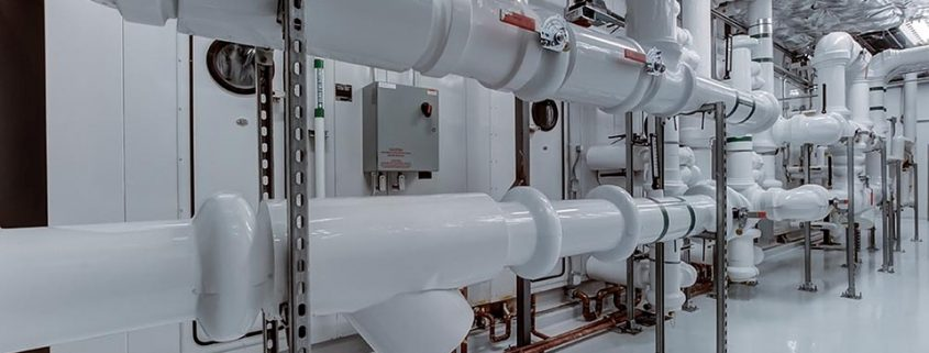 Epoxy paint applied on and in pipes in industrial setting
