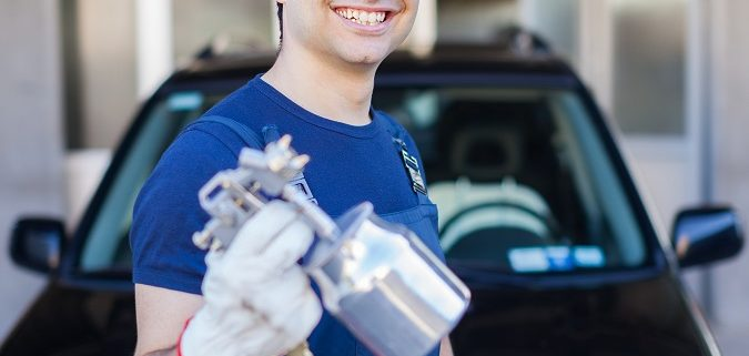 man ready to paint a car using industrial non paint supplies