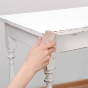 Sanding back chalk paint will give your furniture a vintage charm